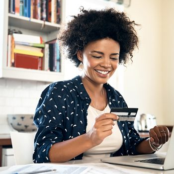 woman paying online with her credit card